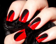 These claw-inspired nails look vampy when done in red and black. // #nailart #halloween