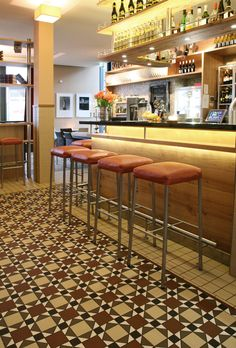"""Sitting on """"Texas Exclusiv"""" bar stools by KFF is certainly conducive to doing business over the counter."""