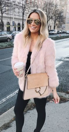 #winter #outfits pink fur coat and black leggings