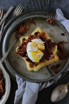 slow cooker pulled pork chili on corn bread waffles