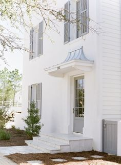 White and lovely, with grey door and shutters.