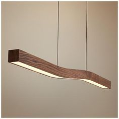 Cerno's Camur LED island pendant is dimmable, made in the USA, and has a frosted polymer shade and dark stained walnut finish.