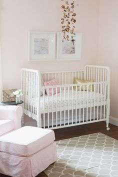 Love this light and girly nursery decor. I'd paint the crib a bright accent color, too