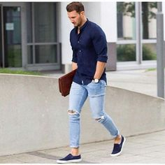 Mens casual fashion. Navy shirt, light blue jeans, slip on sneakers.