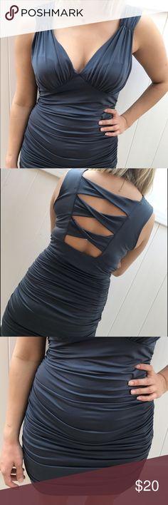 Dark Grey gorgeous stretchy dress. Dark Grey gorgeous stretchy dress with a cute open design in the back. Only worn once! Dresses Mini