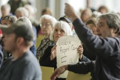 Confrontation, laughter in exchanges at town hall meetings