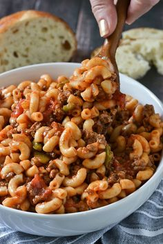 An easy and delicious recipe for Classic American-Style Goulash loaded with ground beef in a tasty tomato sauce just like grandma used to make!