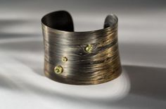 Carbon fiber, galvanized 24K yellow gold, gold-plated sterling silver and peridot cuff bracelet by Maria Rzewuska #igorman #mariarzewuska