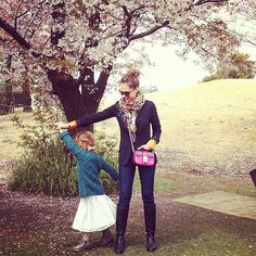 Stylish mom Jessica Alba with her daughter, Honor under a cherry blossom tree.