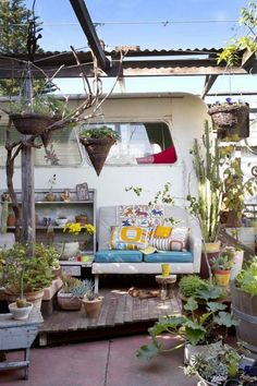 Caravan and exterior     The eclectic home of Trish Bygott, Nathan Crotty and their family in Fremantle, WA, which incorporate a 1950′s bus ...