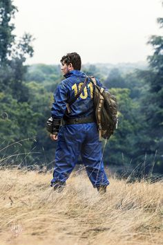 I see him walking around in the 101 vault jumpsuit. I sigh wondering why he is out. I step out of the bush and step on a twig as he turn around I pull out my jayhawk pistol of my 101 armor and point it at him. (Fallout rp anyone? I am the girl that was hiding in the bush.)
