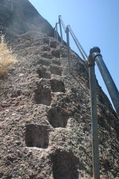 An alternating tread stair climbing the steep slope of a pinnacle in Pinnacles National Monument, California, United States.