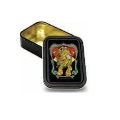 "Rasta Lion Air Tight and Water Resistant Metal Storage Tin, 2 3/4 x by 3 3/4 by Creative Ventures. $9.99. This is a small metal black rectangular tin, airtight and water resistant. It is 2 3/4"" wide by 3 3/4"" long, and 1"" tall. The top is decorated with a bright, glossy sticker of  a rasta lion. Use it to store anything valuable, such as a key, paper money, or anything else that you want to hide away."