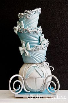 """Such a beautiful cake! """"Topsy Turvey Cinderella Carriage disney Wedding Cake - Cinderella Wedding Cake…I bet it disappeared after midnight! Made by 'Gimme Some Sugar' of Las Vegas. Check em out if you're looking for a custom wedding cake! Gorgeous Cakes, Pretty Cakes, Cute Cakes, Amazing Cakes, Disney Themed Cakes, Disney Cakes, Crazy Cakes, Fancy Cakes, Unique Cakes"""