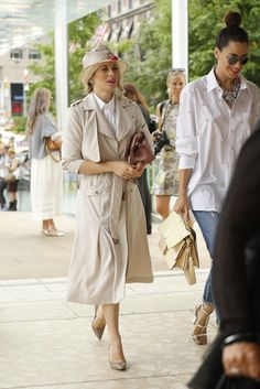 They Are Wearing: New York Fashion Week - In love with the white shirt on the right and statement bling necklace!