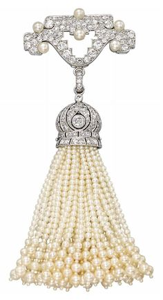 A BELLE EPOQUE PEARL AND DIAMOND BROOCH, BY CARTIER The pavé-set geometrical top with pearl accent suspending a detachable seed pearl tassel pendant with diamond-set openwork cap, 1910s, 9.5 cm Signed Cartier, no. 3016366