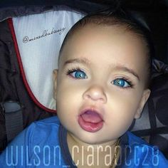 Beautiful baby with amazing blue eyes