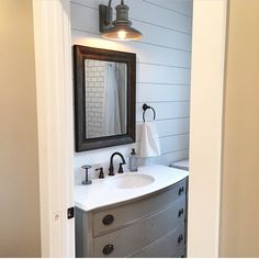 Light fixture and vanity for boys bathroom.