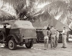 """A medical inspection in the South Pacific of American soldiers for venereal diseases. The term """"short-arm inspection"""" is a military euphemism referring to the routine examination of male soldiers' penises (""""short arms"""") for signs of sexually-transmitted diseases and other medical problems."""