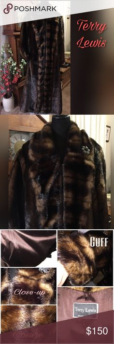 """Beautiful Faux Fur Coat Full length faux fur coat.  It measures 54"""" from neck to hem.  No buttons on this one, but is held closed with fur closures.  The front falls open creating a 'fold' down the front. The folds are stitched in place in 2 or 3 places down the front. This coat is beautiful but heavy. I never wore it. The Pin on the front stays with the coat. Excellent pre- loved condition. Terry Lewis Jackets & Coats"""
