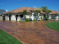 Staining concrete can be an inexpensive way to update the exterior look of your home. Acid stain can be one of the cheapest things you can do and it provides a great bang for your buck. This look is achieved by creating a chemical reaction that alters the color of concrete. Concrete acid stain contains a mixture of water, mineral salts, and muriatic acid. The finished stain will create natural tones that are an impressive improvement from unstained concrete slabs and walkways.