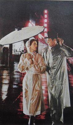 1950s Times Square vintage NEW YORK CITY Man Woman Raincoats Fashion Photo Advertisement