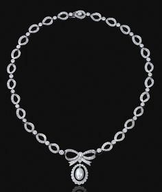 DIAMOND NECKLACE.  Designed as a chain of oval links millegrain-set with circular-cut diamonds, alternating with similarly-cut stones in collet settings, decorated at the front with a bow motif supporting an oval drop pendant with a cultured pearl swing centre,