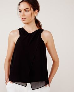 This chiffon criss-cross blouse is perfect for those warm days and nights of summer. Pair with white pants for a sophisticated and modern look.<br /><br />- Sleeveless<br />- Criss-cross detail at the front<br />- Silky crepe lining