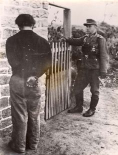 France, A German soldier and a captive of the French resistance.