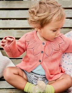 Our supersoft cardigan will keep baby warm and comfortable all day. A range of pretty shades will add a pop of colour to every outfit, and we've also added link stitch detailing around the collar, just for fun. It's fully machine washable, too.