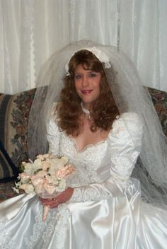 Kymberley was dressed into her very beautiful wedding gown by her very beautiful girl friend Paula Chester.  Paula Chester will marry her very beautiful girl friend Kymberley.  Kymberley will be known forever as Kymberley Chester.     gmmg