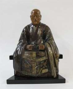 A Japanese polychromed and lacquered wood portrait sculpture of a seated monk<z> <br />  <br /> edo period<z> <br />  <br />  <br /> H: 16 1/2 in., 42 cm <br />  <br />  <br />  <br /> PROVENANCE: <br />  <br /> Property from DeHoogh Gallery, to be offered without reserve<z>