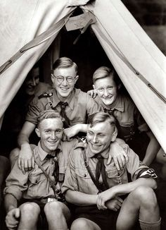 """A group of Hitler Youth on a summer camp outing. The sign at the top of the tent somewhat oddly reads """"Freimaurerloge"""" (Freemasons Lodge)."""