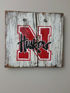 Nebraska Corn Huskers hand painted sign on reclaimed wood