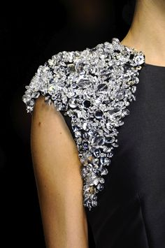 Crystal encrusted shoulder - glam bead embellished dress close up; sparkly fashion details