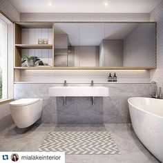This beautiful bathroom installed in Navlam Chalked Walnut by Mia Lake Interiors