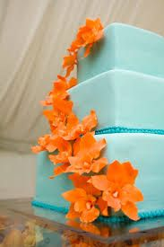 Image result for two tier orange and blue wedding cake
