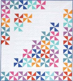 Pretty pinwheel blocks in bright colors make up this versatile x lap quilt. Scrappy Quilts, Easy Quilts, Mini Quilts, Owl Quilts, Pinwheel Quilt Pattern, Scrap Quilt Patterns, Half Square Triangle Quilts, Square Quilt, Colorful Quilts