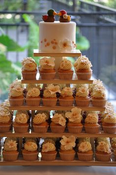 Wedding cupcake tower in shades of gold and ivory, with Korean ducks topper.   by Julie Desmeules