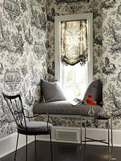 Cozy window seat...love the toile.