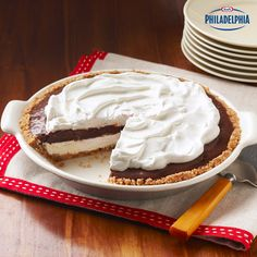 Made with vanilla wafers, pecans and chocolate pudding, this Mud Pie is perfect for any after-dinner treat or social gathering. And of course, it's best served with a tall glass of milk! #recipe #dessert #creamcheese