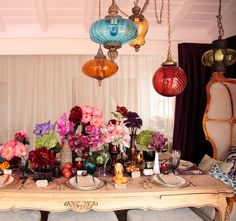 Boho brunch table. Beautiful bohemian tablescape, with rich vibrant colors, hanging Moroccan-style lamps, jewel tone flowers and vases, with accents of luscious fresh fruits. See more at http://pinterest.com/wineinajug/party-wedding-decor/