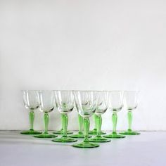 A set of 10 clear and green glass sherry glasses