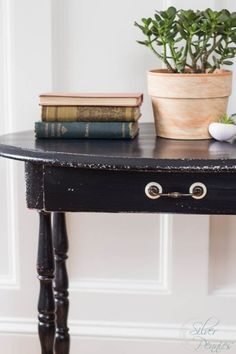 Vingette of books and plants - a vintage table painted in Lamp Black.