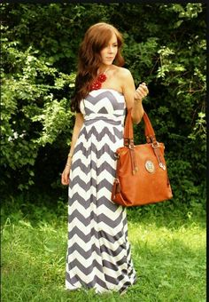 A gray long chevron strapless dress.