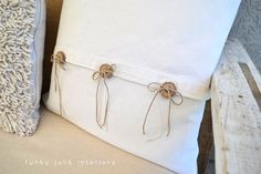 Pillow with buttons - could use green or black buttons with black thin ribbon hanging down