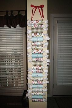 advent calendar - made from stapled together toilet paper rolls wrap the goodies/verse in tissue paper to make it look like candy!!!....Genius!
