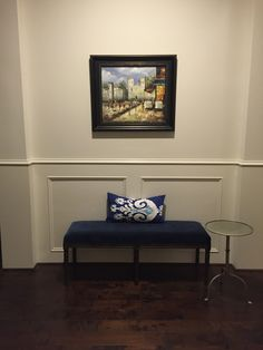Painting from Paris, custom bench from Restoration Hardware, and pillow from Pottery Barn.