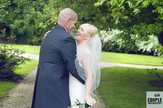 Stealing a kiss. Weddings at The Johnstown Estate, photographed by Couple Photography.