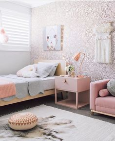 Design devotee girls bedroom in pastels and gold.